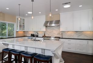 Contemporary Kitchen with Pental - zebrino polished marble, Undermount sink, Casement, can lights, Pendant light, Glass panel