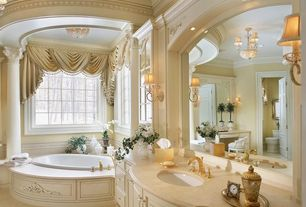 Traditional Master Bathroom with specialty door, Master bathroom, picture window, Bathtub, Limestone counters, Wall sconce