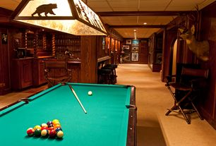 Traditional Game Room with six panel door, Built-in bookshelf, Columns, Standard height, can lights, Crown molding, Carpet