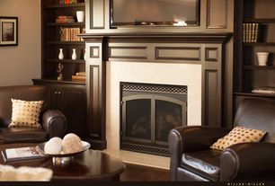Traditional Living Room with Standard height, Fireplace, Built-in bookshelf, Hardwood floors, metal fireplace