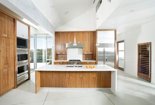 Contemporary Kitchen with Concrete tile , Kitchen island, High ceiling, double wall oven, Wall Hood, U-shaped, Shoji door