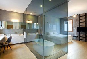 Contemporary Master Bathroom with Rain shower, Freestanding, Laminate floors, Concrete counters, Vessel sink, Master bathroom