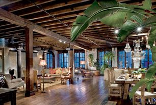 Eclectic Great Room with Chandelier, Exposed beam, Columns, Hardwood floors, Wall sconce, Arched window
