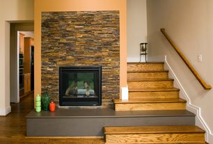 Contemporary Staircase with High ceiling, stone fireplace, Hardwood floors