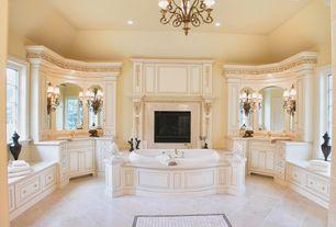 Traditional Master Bathroom with Chandelier, Limestone, Master bathroom, Limestone counters, specialty door, Window seat