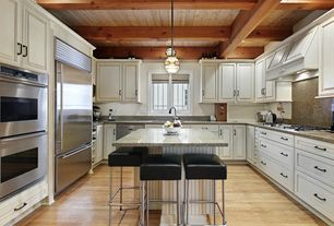 Traditional Kitchen with Kitchen island, can lights, double wall oven, U-shaped, Simple granite counters, full backsplash
