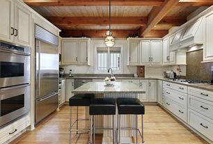 Traditional Kitchen with Kitchen island, Exposed beam, Simple granite counters, Custom hood, Pendant light, flush light