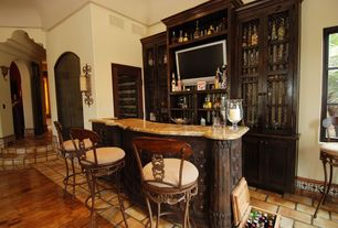 Mediterranean Bar with Laminate floors, Wall sconce, High ceiling, Built-in bookshelf