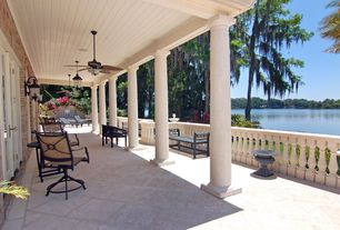 Traditional Porch with Newport outdoor swivel chair, Capital garden shallow urn, exterior tile floors, French doors