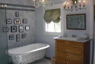Eclectic Master Bathroom with ceramic tile floors, Inset cabinets, frameless showerdoor, Honed marble wall tile, Chandelier