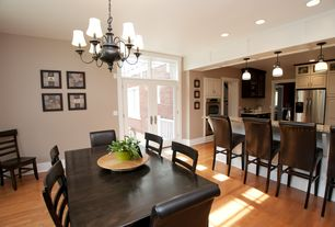 Traditional Dining Room with French doors, Hardwood floors, Chandelier, Transom window, Standard height