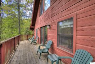 Rustic Deck with Wrap around porch, French doors