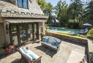 Traditional Patio with Pathway, exterior awning, exterior tile floors, French doors