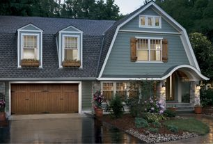 Country Exterior of Home with Paint 1, Wood shutters, Rustic garage door, double-hung window, Gambrel roof