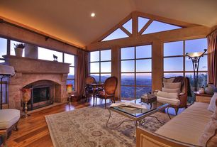 Traditional Living Room with Fireplace, Cement fireplace, Metal coffee table glass top, Hardwood floors, Cathedral ceiling