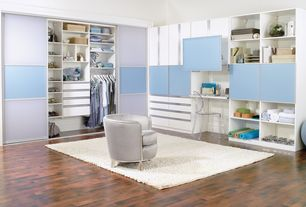 Contemporary Closet with Laminate floors, Area rug, High ceiling, Custom cabinetry, Frosted glass sliding closet doors