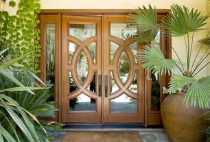 Contemporary Front Door with exterior tile floors, Double door, French doors, Large urn planters, Sidelights, Exterior wall
