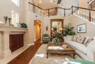 Traditional Living Room with Balcony, picture window, High ceiling, Cement fireplace, Fireplace, Hardwood floors