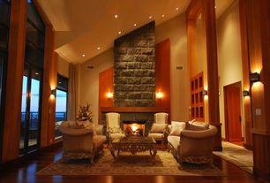 Contemporary Living Room with Wall sconce, stone fireplace, High ceiling, Louvered door, Laminate floors