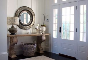 Traditional Entryway with Wood panel wall, Wide base boards, Paint, Concrete floors, Standard height, Transom window