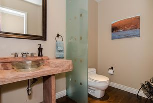 Contemporary Powder Room with Limestone counters, Hardwood floors, Powder room, Vessel sink