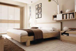 Contemporary Master Bedroom with Hardwood floors, Built-in bookshelf, Standard height, Pendant light, specialty window