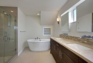Contemporary Master Bathroom with Freestanding, Double sink, Limestone counters, can lights, Undermount sink, Wall Tiles