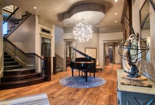Contemporary Entryway with can lights, Crown molding, Chandelier, Wainscotting, Hardwood floors, Standard height