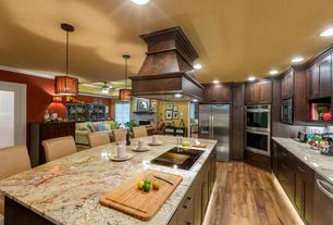 Craftsman Kitchen with Flat panel cabinets, Pendant light, L-shaped, European Cabinets, Complex granite counters, Subway Tile