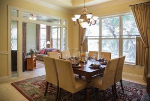 Traditional Dining Room with Columns, limestone tile floors, Chandelier, Microfiber parsons dining chairs, Tie-back curtains