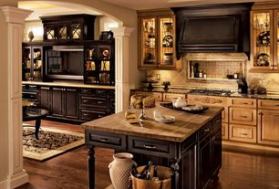 Country Kitchen with Wood counters, Custom hood, Stone Tile, full backsplash, Kitchen island, Framed Partial Panel, One-wall