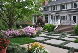 Traditional Landscape/Yard with Deck Railing, exterior stone floors, Pathway, French doors, double-hung window