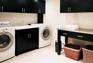 Contemporary Laundry Room with laundry sink, Built-in bookshelf, can lights, limestone floors, drop-in sink, Standard height