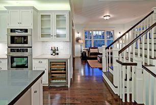 Traditional Staircase with Floating staircase, High ceiling, Crown molding, Hardwood floors