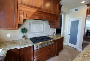 Traditional Kitchen with Stone Tile, L-shaped, French doors, electric cooktop, Limestone Tile, stone tile floors, Custom hood