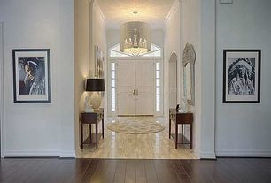 Traditional Entryway with Arched window, High ceiling, French doors, Chandelier, simple marble tile floors, Crown molding