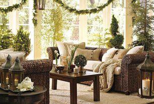 Traditional Living Room with potterybarn seagrass sofa, Laminate floors, DMi Del Mar Coffee Table, Dalton shag rug - ivory