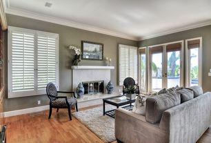 Modern Living Room with Cement fireplace, Standard height, Fireplace, Built-in bookshelf, Hardwood floors, Casement