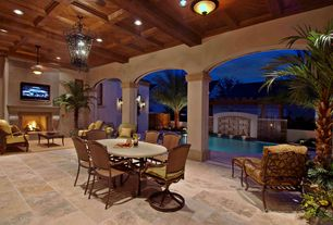 Mediterranean Patio with Fence, exterior stone floors, Trellis
