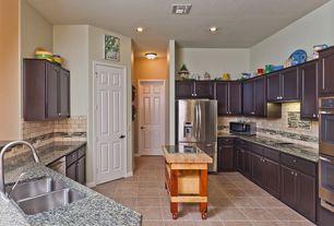 Traditional Kitchen with Limestone Tile, Stainless undermount 2-basin sink, U-shaped, Flat panel cabinets, Stone Tile, Flush