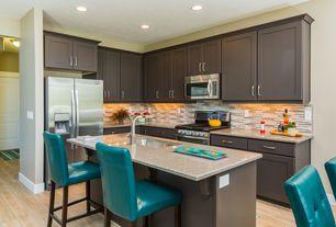 Modern Kitchen with Breakfast bar, Undermount sink, Decolav granite countertop in carmello, Pier1 bar chair, Kitchen island