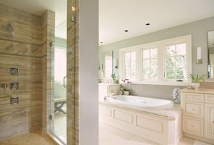 Traditional Master Bathroom with Wall sconce, Complex marble counters, Raised panel, Ceramic Tile, Vinyl floors, Jetted