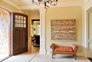 Traditional Entryway with Glass panel door, Chandelier, Crown molding, High ceiling, Concrete tile