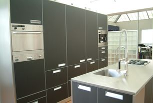 Contemporary Kitchen with European Cabinets, Corian counters, One-wall, Flush, Brooks Custom Stainless Steel Countertops