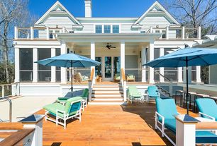 Traditional Deck with French doors, Fence, California Umbrella 9' Umbrella with Sunbrella Fabric