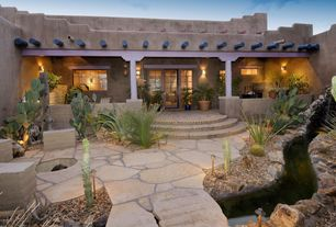Eclectic Landscape/Yard with Arizona Flagstone, Trellis, Fence, Fire pit, exterior stone floors, Pond