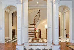 Traditional Staircase with Wainscotting, can lights, curved staircase, High ceiling, Hardwood floors