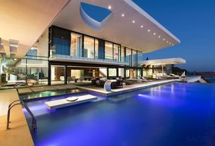Modern Swimming Pool with Infinity pool, Deck Railing, Pathway, exterior stone floors, sliding glass door, picture window