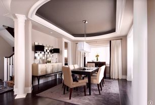 Contemporary Dining Room with Columns, Chandelier, Hardwood floors