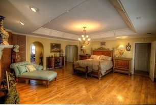 Traditional Master Bedroom with Chandelier, can lights, Fireplace, Crown molding, interior brick, six panel door